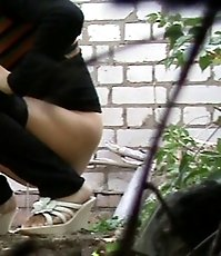 Amateur chick captured pissing outdoors