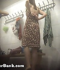 Cute girl in bright dress strips in spycammed room