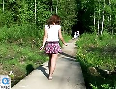 Shameless young girl caught peeing on park path