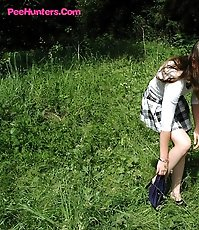 Teen schoolgirl sits down for an outdoor piss