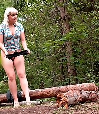 Shameless blonde hoochie peeing at a picnic site