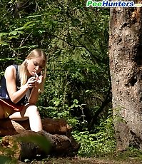 Girl stops to smoke a cig and take a leak in woods