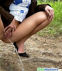 Hot young chick sits down to take a leak alfresco