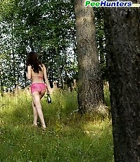Naughty smoking girl takes a leak in the woods
