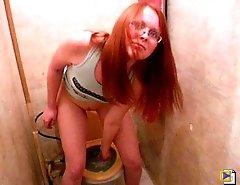 Cute girl in glasses lets everyone see her peeing