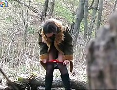 Horny teen peeing in forest