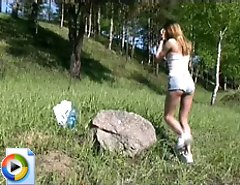 Sexy shaved teen peeing outdoor