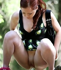 Cute young redhead got busted pissing in the woods