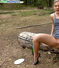 Shameless blonde hoochie peeing at a picnic glade