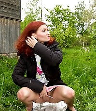 Spying on redhair teen peeing near road