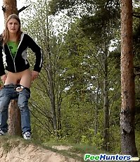 Beautiful teen plays watersports on a quiet forest glade