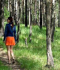 Young babe goes for a wee on an empty forest path