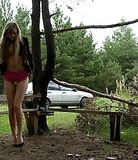 Beautiful blonde caught pissing at a camping site