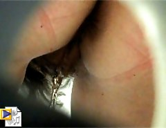 Wet slits of pissing girls get filmed in close-up
