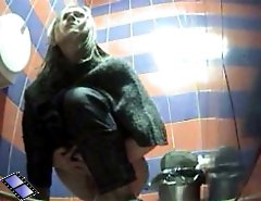Two hotties urinates onto spy cam in public loo