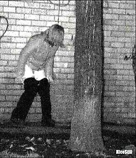 Girl takes a secret leak in the street at night