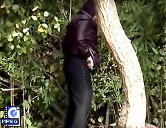 Voyeur clips of a squatted gal taking a leak outdoors