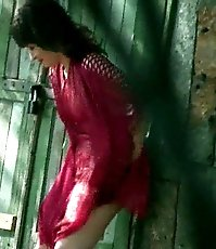 Babe in crimson piddles outdoors unaware of spying