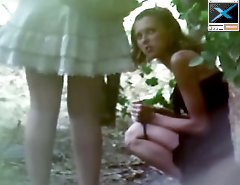 Two awesome girls urinating outdoors under control