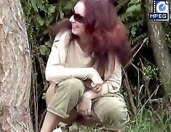 Unsuspecting girl in sunglasses pees in voyeur clips