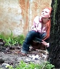 Hot girl with red hair filmed on the sly having a pee