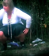 Big-titted fatty empties her bladder in voyeur pics