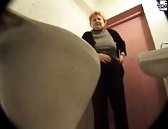 Mature and young babes taking turns to pee in spycammed john